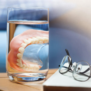 Denture in a cup